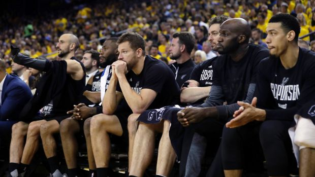 Spurs players look on as their team gets thrashed.