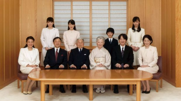 Japanese Emperor Akihito, seated third left, and Empress Michiko, seated fourth left, smile with their family members ...
