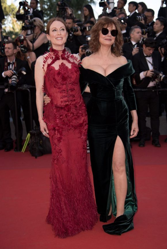 Susan Sarandon (R) and Julianne Moore (L) arrive for the Opening Ceremony of the 70th annual Cannes Film Festival.
