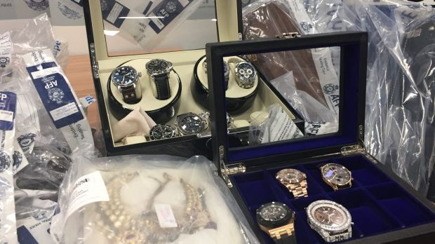 Police have seized hundreds of items, including $500,000 in watches, but believe half of the syndicate's $165 million ...