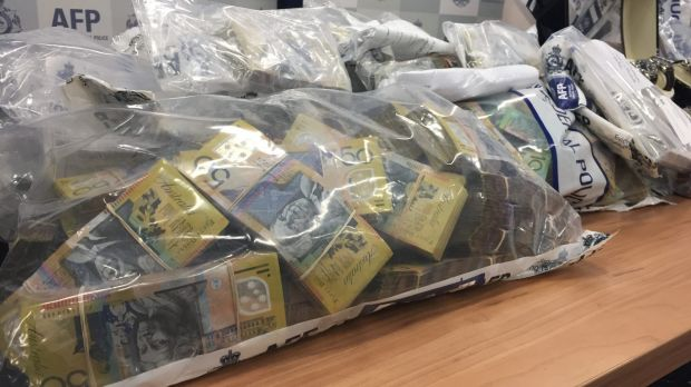 Police seized $1 million from a safe deposit box during Wednesday's raids.