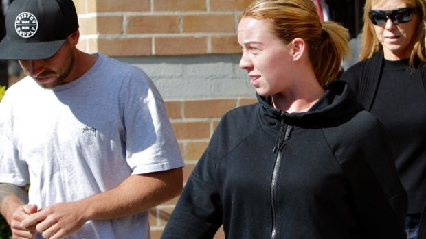 Devyn Hammond, one of the alleged conspirators, leaves Wollongong police station.