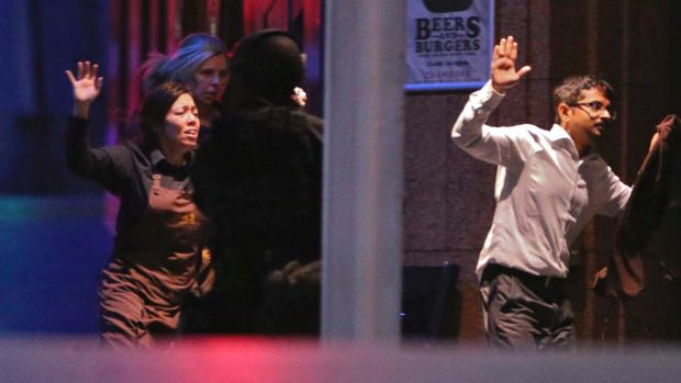 Hostages escape from the Lindt cafe during the siege.