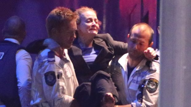 Police Rescue officers carry injured hostage Marcia Mikhael in Martin Place.