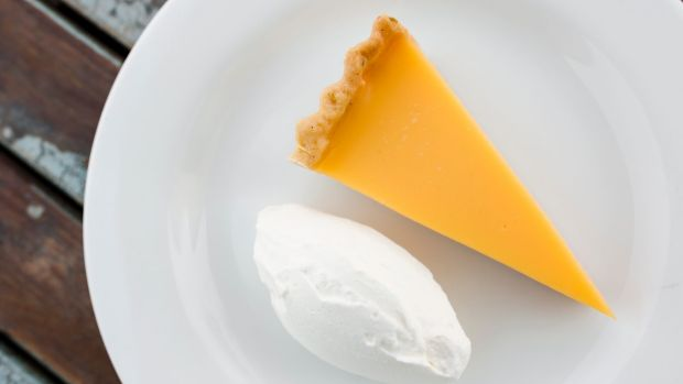 Zingy tang with crisp pastry: Lemon tart with fresh cream.