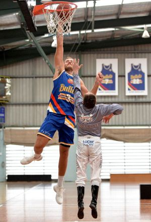 Jockey Larry Cassidy was paired up against Brisbane Bullets player Mitch Young.