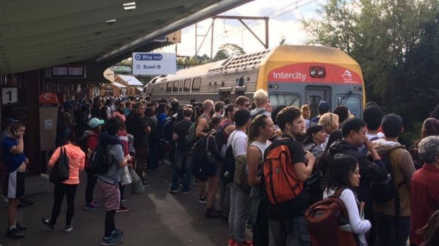 A crowd of people waiting for a train to arrive at Katoomba Station on a Sunday afternoon.