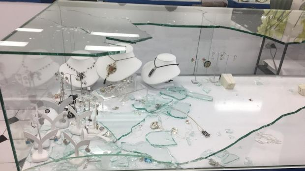 One of the smashed cabinets inside Jafari Jewellery on Thursday.