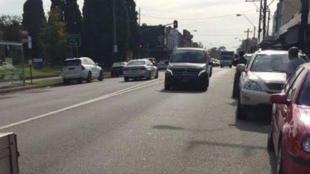 Store owner Mohamed Jafari managed to get this photo of the getaway car, a silver BMW (left, driving away).