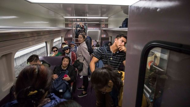 """""""We're jammed in like sardines ..."""": passenger Kylie Fearnley said of Sunday train travel."""