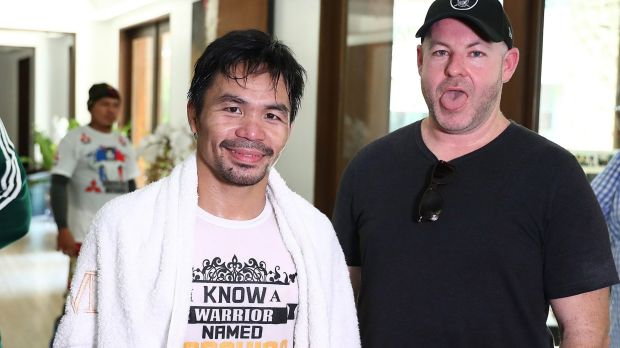 Working up a sweat: Manny Pacquiao with Andrew Webster after a training run on the streets of Manila.