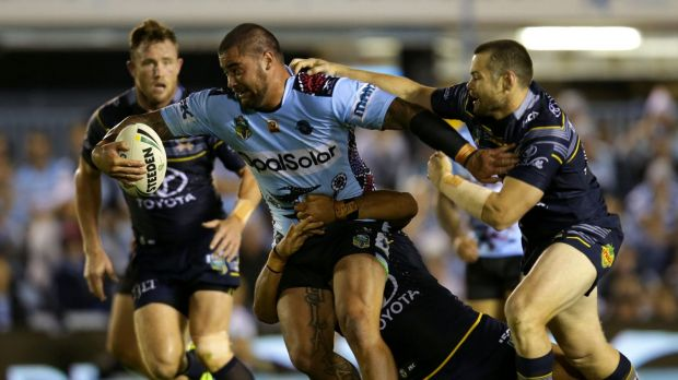 Smash and grab: Andrew Fifita forces his way through the defensive line.