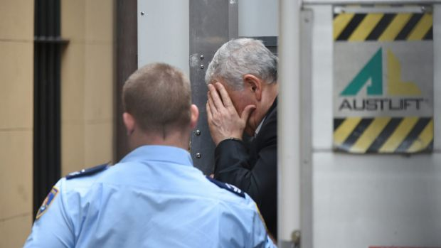 Haydar Haydar hides his face as he arrives at the Supreme Court on Friday.