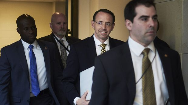 Rod Rosenstein, US deputy attorney-general, centre, arrives for a meeting with the Senate on Thursday.