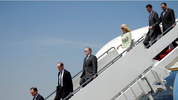 Under fire: Members of Donald Trump's staff disembark from Air Force One upon the President's arrival at Joint Base ...