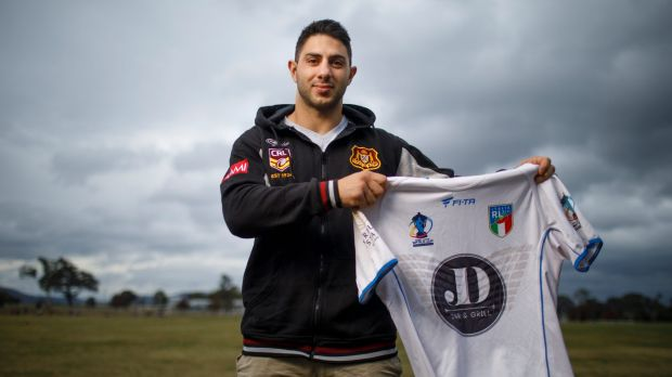 Former Gungahlin Bulls Rugby league player Anthony Onorato holds an Italian rugby league jersey belonging to Dragons ...