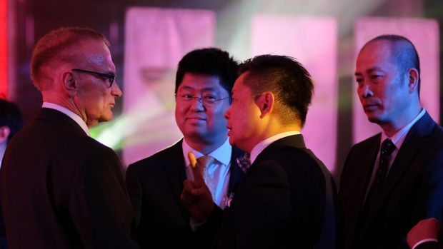 Ian Tang, centre, chairman of the 123 AustChina Education Consultancy, talks to former foreign minister and NSW premier ...