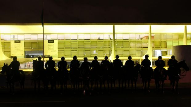 Mounted police guard the Palacio do Planalto, Brazil's seat of government, after protests erupted on Thursday.