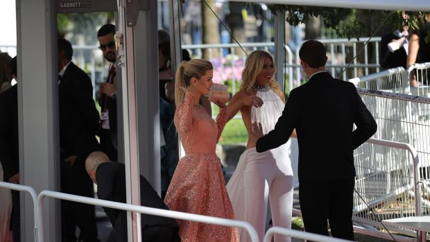 Guests go through security screening as they arrive for the screening of Ismael's Ghosts (Les Fantomes d'Ismael) and the ...