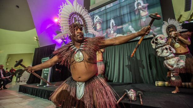 A Torres Strait dance group performed in full mask and tribal costumes to launch a new exhibition at the National Museum ...