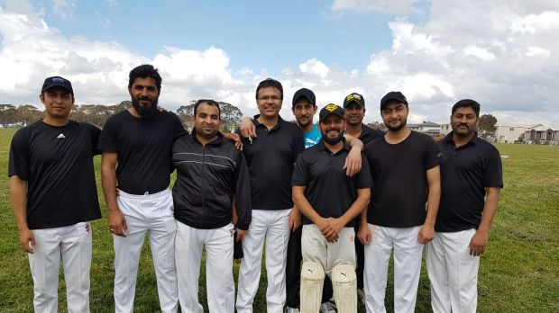 Zeeshan Akbar (back centre) with his cricket mates from the 'Canberra Sharks'.