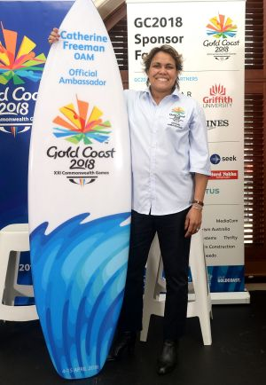 Cathy Freeman with her new surfboard.