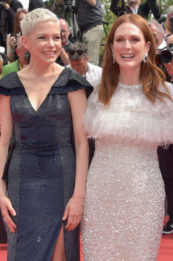 """Michelle Williams (L) and Julianne Moore attend the """"Wonderstruck"""" screening during the 70th annual Cannes Film Festival."""