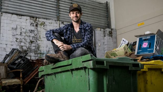 Dumpster divers comb supermarket bins in search of useful food.