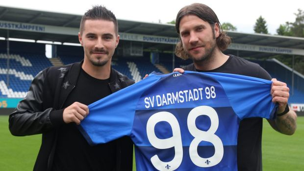 Fresh start: Jamie Maclaren shows off his new colours with coach Torsten Frings.