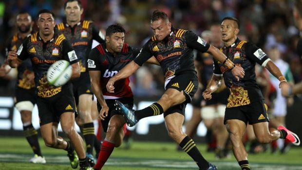 Downtown: Aaron Cruden clears the ball. His wayward kicking off the tee opened the door for the Crusaders.