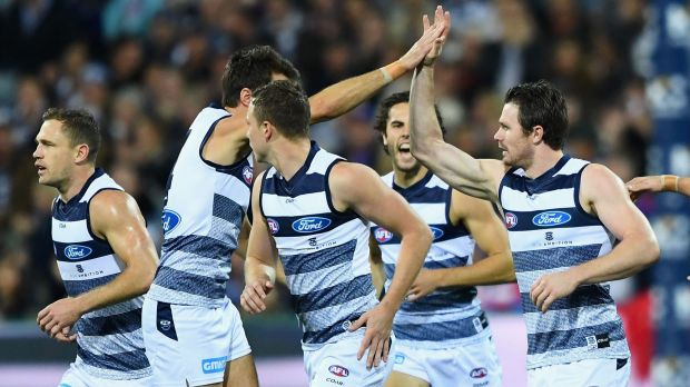 Patrick Dangerfield (right) is congratulated by teammates after kicking a goal.