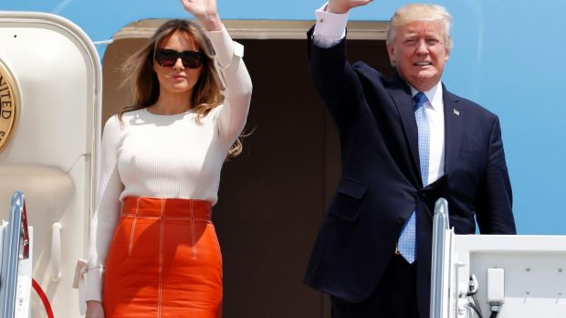 Donald Trump and first lady Melania Trump, wave as they board Air Force One for his first overseas trip as President.