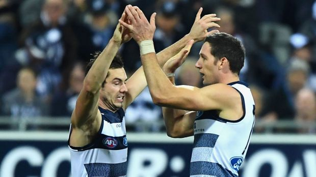Harry Taylor (right) is congratulated by teammate Daniel Menzel.