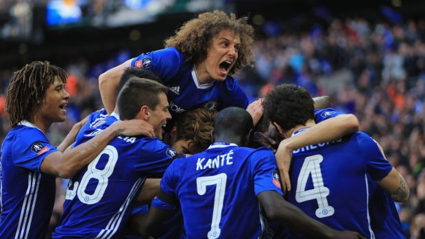David Luiz (centre) has splashed out on his teammates after their EPL title win.