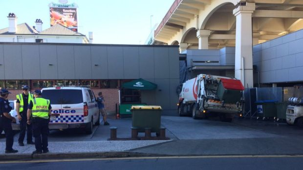 A man has been hit by his own garbage truck next to the Story Bridge Hotel.