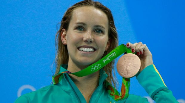 Australian swimmer Emma McKeon holds her Rio bronze medal. Many have been returned because of rust.