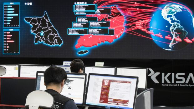 Employees watch electronic boards to monitor possible ransomware cyberattacks at the Korea Internet and Security Agency ...