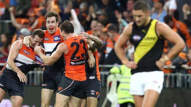 Out of jail: Jeremy Cameron and teammates celebrate the GWS Giants' comeback win against Richmond on Saturday night.