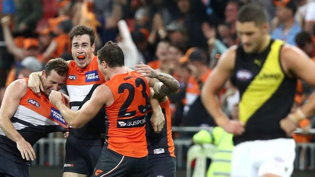 Out of jail: Jeremy Cameron and teammates celebrate the GWS Giants' comeback win last month.