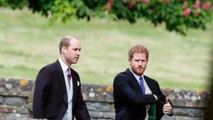 Britain's Prince William, left, and his brother Prince Harry arrive for the wedding of Pippa Middleton and James ...