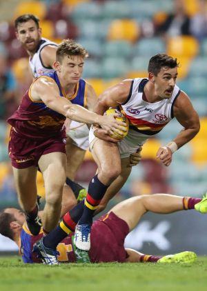 On the burst: Taylor Walker kicked three goals in the Crows' big win over Brisbane.