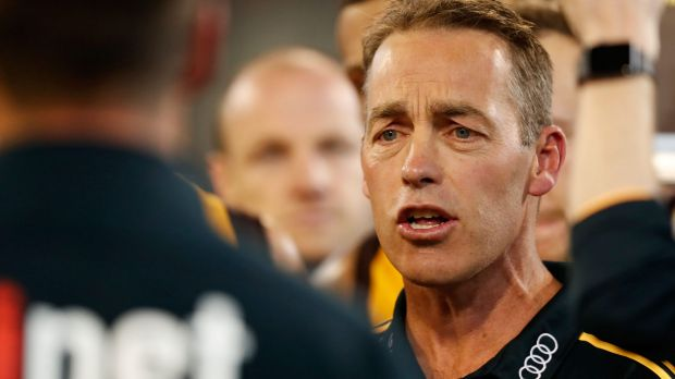 Alastair Clarkson speaks with his players at the MCG.