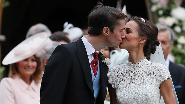 Pippa Middleton and James Matthews kiss after their wedding at St Mark's Church in Englefield.