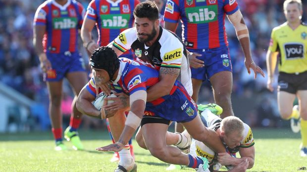 Grounded: Sione Mata'Utia is tackled by James Tamou.