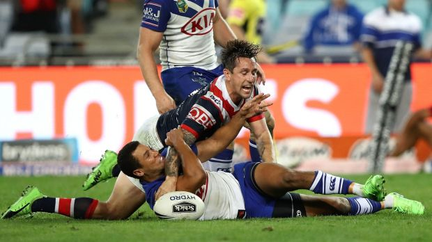 Mitchell Pearce of the Roosters scores the winning try during the round 11 NRL match between the Canterbury Bulldogs and ...
