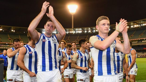 Victorious again: Todd Goldstein and Jack Ziebell lead the Kangaroos off the MCG.