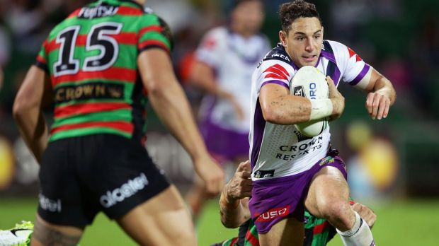 Elusive: Billy Slater breaks free from the Bunnies.