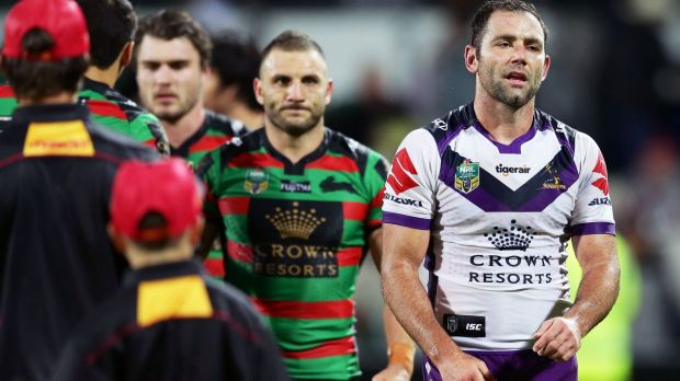 Battle of attrition: Robbie Farah and Cameron Smith walk from the field after a draining match.