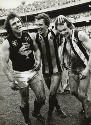 Wayne Harmes, Ken Sheldon and Jimmy Buckley (the latter pair having swapped guernseys) celebrate the 1979 grand final win.