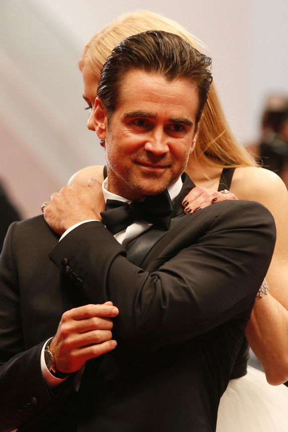 Actress Nicole Kidman, at rear and Colin Farrell also shared embraces and a few moments on the red carpet of their film ...